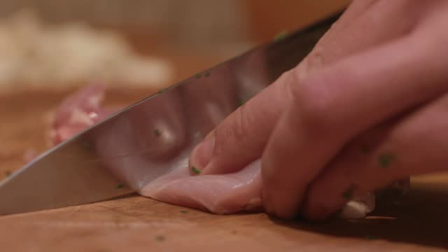 Chef Chopping Chicken Breast Fillets, Close Up