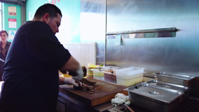 chef chopping meat in mexican restaurant - catering occupation stock videos & royalty-free footage