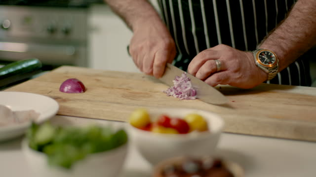 chef chopping onion - chopped lettuce stock videos & royalty-free footage