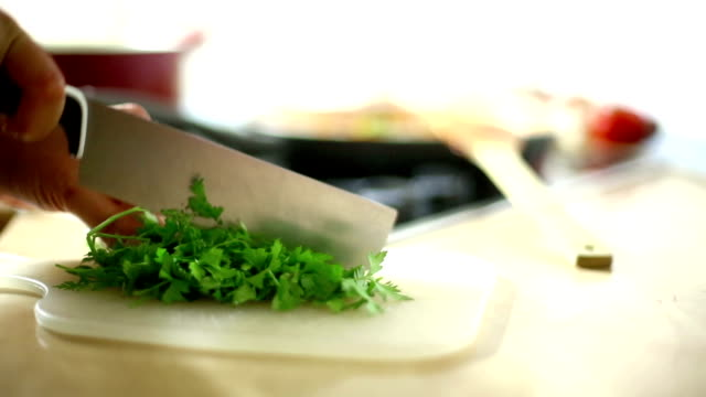 chef chopping parsley on kitchen counter. - parsley stock videos and b-roll footage