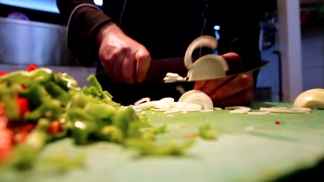 chef chops a white onion - dollop stock videos and b-roll footage