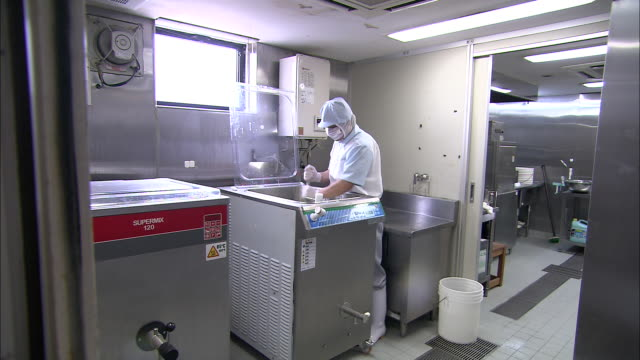 a chef chops wasabi in a restaurant kitchen. - wasabi stock videos and b-roll footage