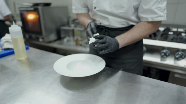 chef cleaning plate at commercial kitchen - utensil stock videos & royalty-free footage