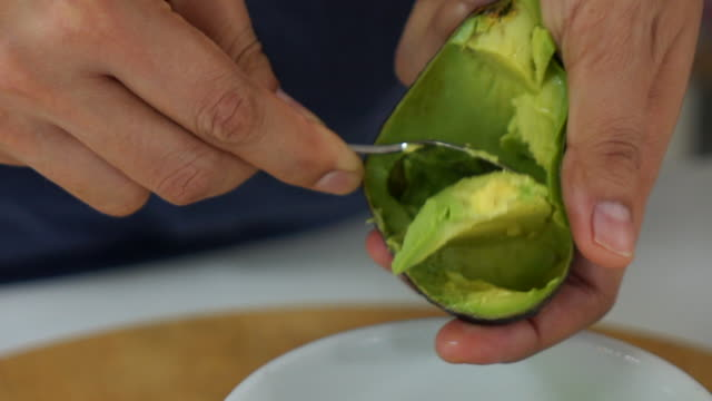 chef cooking avocado fruit in the kitchen - avocado salad stock videos & royalty-free footage