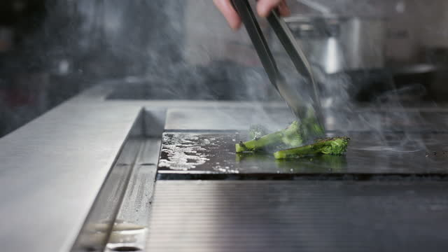 chef cooking broccoli on hot plate - crucifers stock videos & royalty-free footage