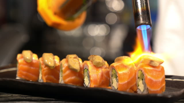 chef cooking burning foie gras salmon sushi maki japanese food. - flaming torch stock videos & royalty-free footage