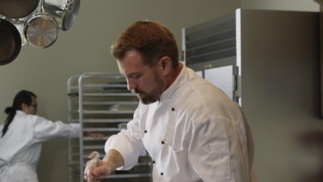 ms td chef cooking in kitchen / orem, utah, usa - orem utah stock videos & royalty-free footage