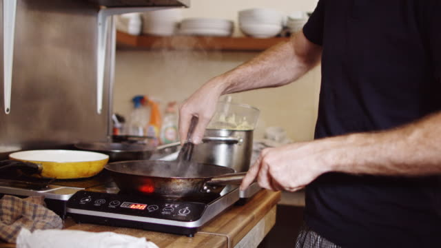 chef cooking in small cafe kitchen - appliance stock videos and b-roll footage