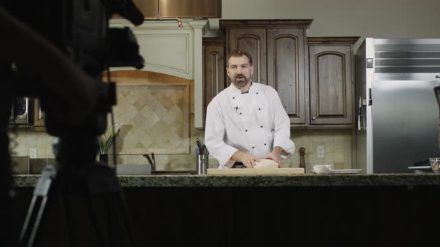 MS PAN Chef cooking in studio and being filmed / Orem, Utah, USA