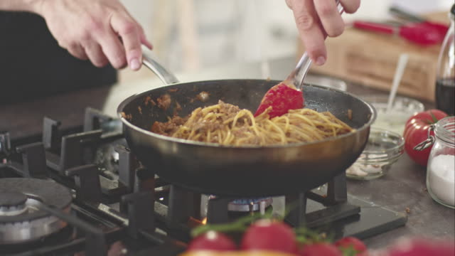 chef cooking spaghetti - stove stock videos & royalty-free footage