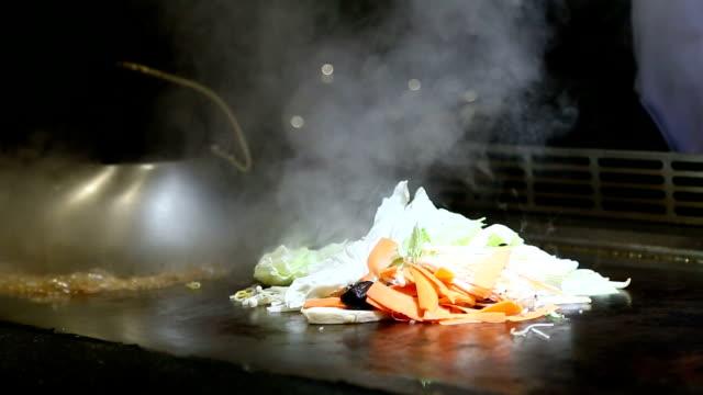 Chef cooking teppanyaki