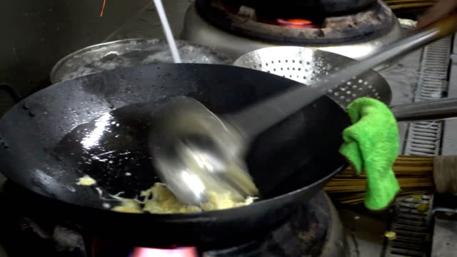 chef cooks chinese food - fried rice stock videos and b-roll footage