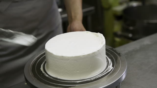 CU Chef covering cake with whipped cream / Kyoto, Japan