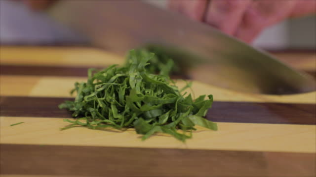 chef cutting baby spinach leaves for a salad - spinach salad stock videos & royalty-free footage