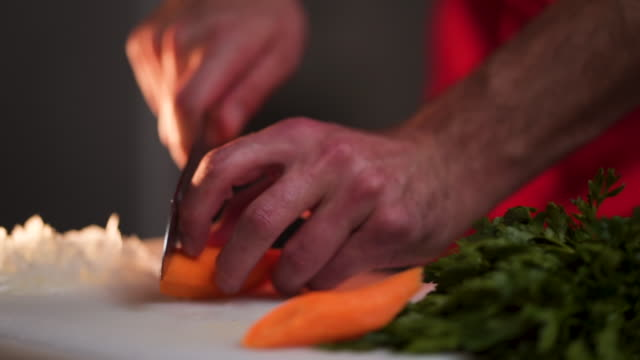 chef cutting carrot - chopped stock videos & royalty-free footage