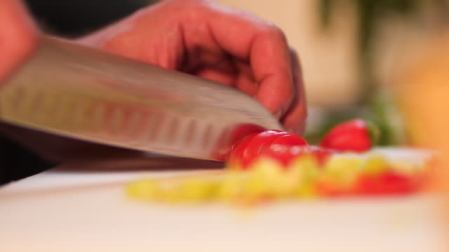 chef cutting cherry tomato - frying pan stock videos & royalty-free footage