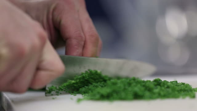 chef cutting chive - chive stock videos & royalty-free footage