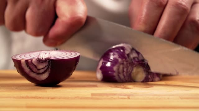 chef cutting onion - red onion stock videos & royalty-free footage
