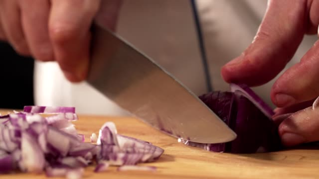 chef cutting onion - chopped food stock videos and b-roll footage
