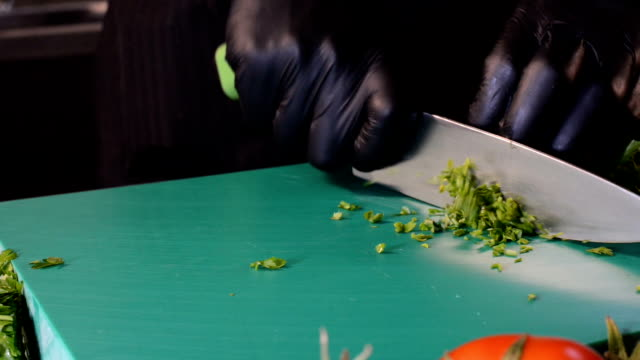 chef cutting parsley in the kitchen - raw food diet stock videos & royalty-free footage