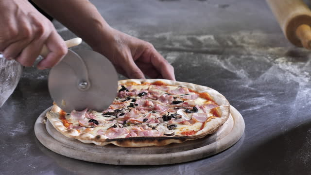 chef cutting pizza - italian food stock videos and b-roll footage