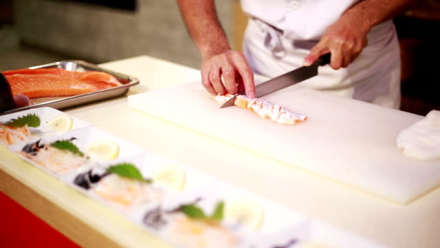 chef cutting salmon seafood. - exoticism stock videos & royalty-free footage
