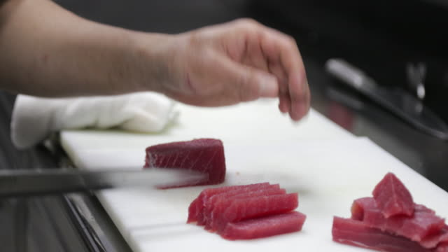 chef cutting tuna fish fillet on slices for sashimi - sashimi stock videos & royalty-free footage