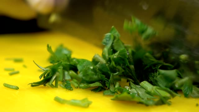 chef cutting up parsley with a knife - parsley stock videos and b-roll footage