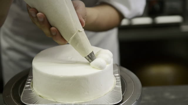 cu chef decorating on birthday cake / kyoto, japan - decorating a cake stock videos and b-roll footage