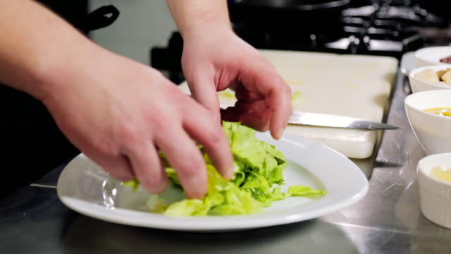 chef dressing green salad - green salad stock videos & royalty-free footage