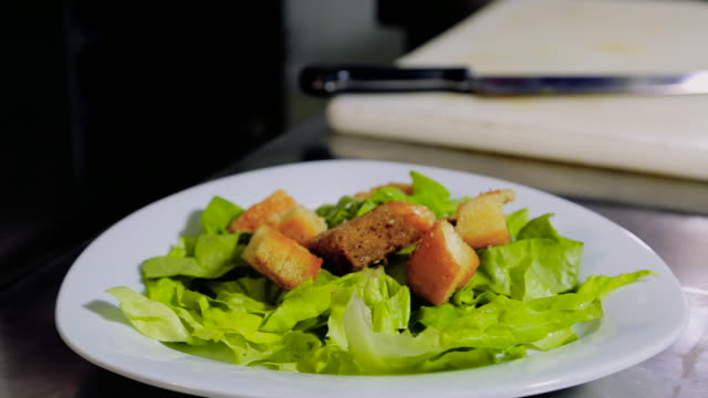 chef dressing green salad with bread - green salad stock videos & royalty-free footage