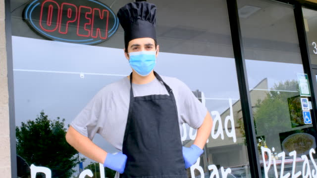 chef fast food restaurant owner posing wearing a mask and protective gloves - emigration and immigration stock videos & royalty-free footage