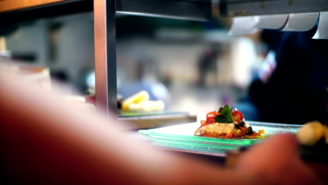 chef finishing meals at a fine dining restaurant. - kitchen stock videos & royalty-free footage