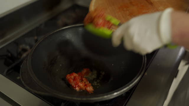 chef frying chicken meat in wok at commercial kitchen - glove stock videos & royalty-free footage