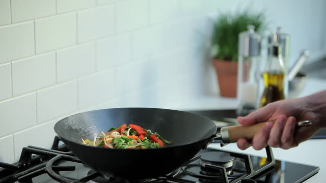 chef frying food on hob - pepper vegetable stock videos & royalty-free footage