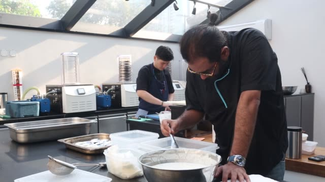 chef gaggan anand prepares 'yogurt explosion' in the research and development kitchen at gaggan restaurant in bangkok thailand on friday may 5 2017 - molecular gastronomy stock videos & royalty-free footage