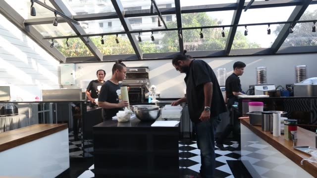 chef gaggan anand prepares 'yogurt explosion' in the research and development kitchen at gaggan restaurant in bangkok thailand on friday may 5 chef... - molecular gastronomy stock videos & royalty-free footage