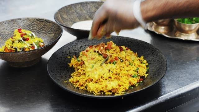 chef garnishing the biryani - food styling stock videos & royalty-free footage