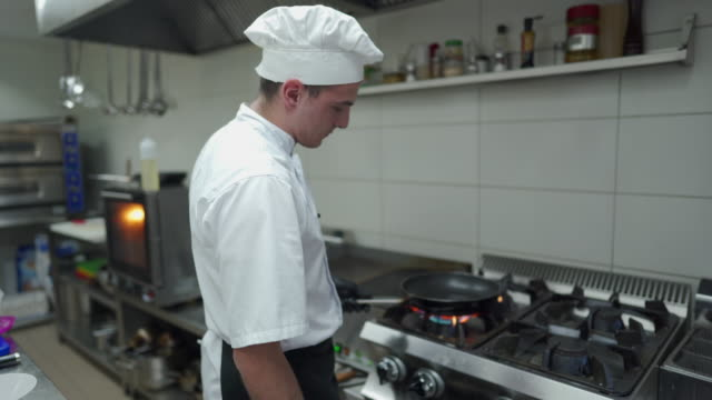 chef getting ready for cooking at commercial kitchen - chef's hat stock videos & royalty-free footage