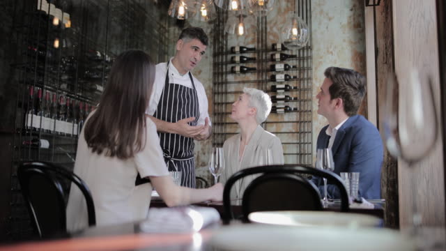 chef greeting customers in his restaurant - guest stock videos & royalty-free footage