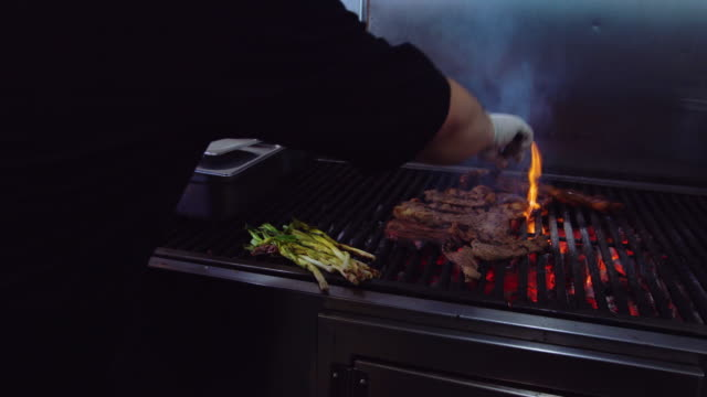 chef grilling meat and onions in taqueria - grilled stock videos & royalty-free footage