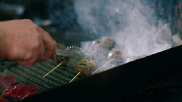 chef grills lamb kebabs on a barbecue - work tool stock videos & royalty-free footage