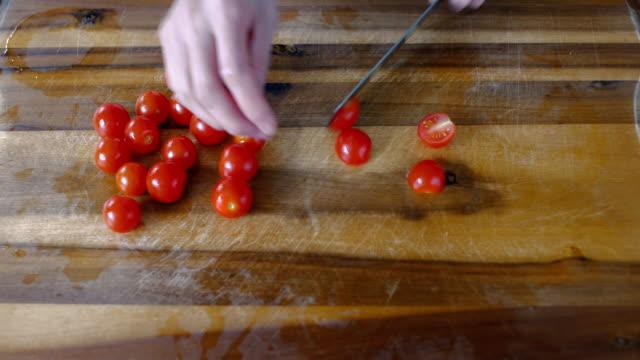 chef halve  cherry tomatoes - cherry tomato stock videos & royalty-free footage