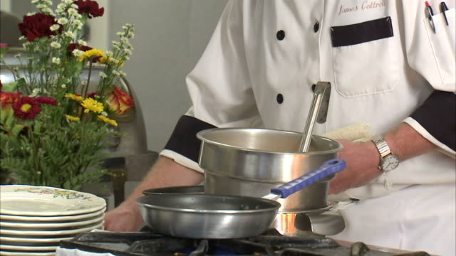 cu chef handling ingredients behind stove / orem, utah, usa - only mature men stock videos & royalty-free footage