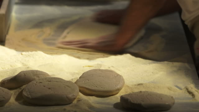 chef handling pizza dough close-up - geschwindigkeit stock videos & royalty-free footage