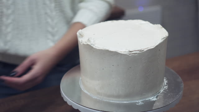 chef hands frosting  the cake with metal spatul - icing stock videos and b-roll footage