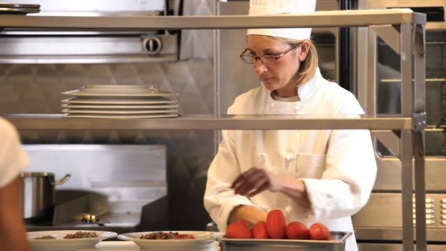 ms chef in restaurant kitchen preparing plates of food, giving plates to waiter / richmond, virginia, usa - richmond virginia stock videos & royalty-free footage