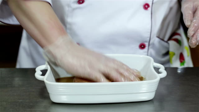 chef is preparing a meat dish in the restaurant. - marinated stock videos & royalty-free footage
