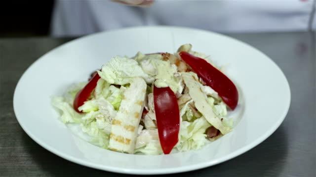 chef is preparing caesar salad at the restaurant. - salad stock videos & royalty-free footage