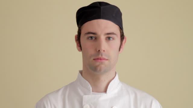 CU Chef loking at camera and smiling